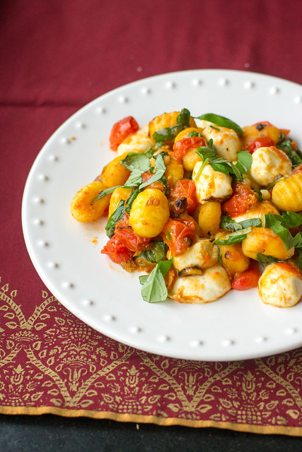 Pan-fried gnocchi with oven-roasted tomatoes, mozzarella, and fresh basil - a perfect little indulgence or date-night meal!