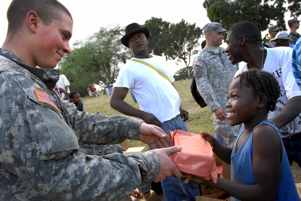 82nd Airborne Soldiers Provide Aid Soldiers With The 1st