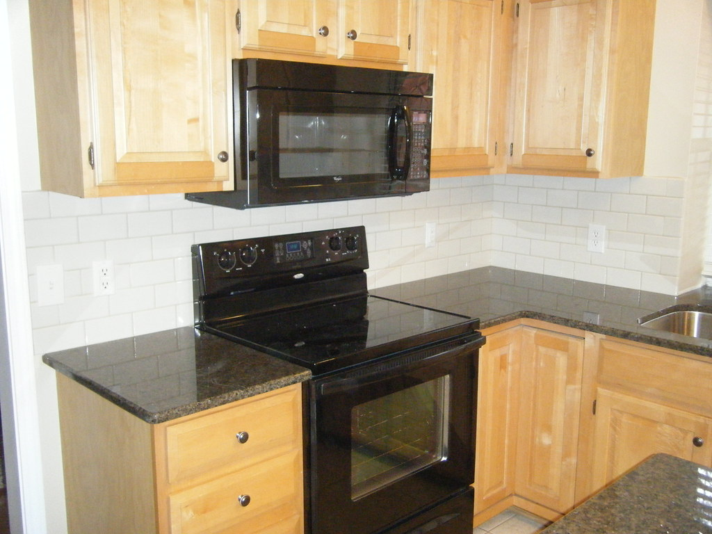 Tropic Brown Granite Countertop With Tile Backsplash Flickr