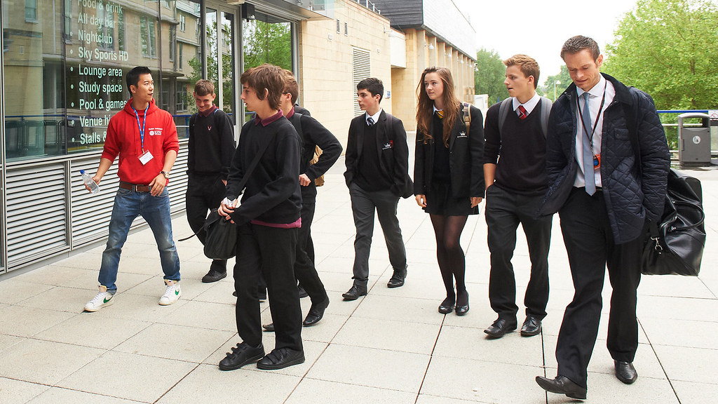 A group of school pupils being shown around the University of Bath campus