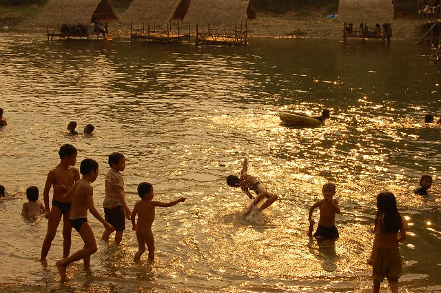 Children swimming in river in Vang Vieng | We found these ...