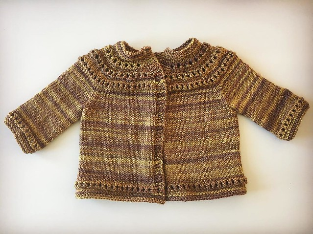 New eyelet yoke sweater, in handspun this time. Sleeves may be a little short- I used every inch of the yarn I had. Fiber is superwash merino and seacell. #knitting #handspun #babyknits