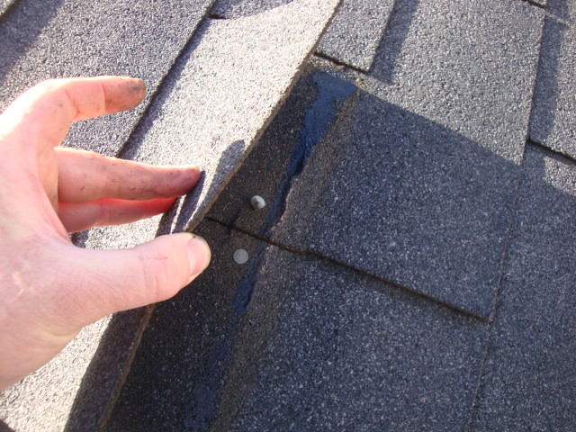 Nail Coming Through Shingle Roof Or Eavestrough Is