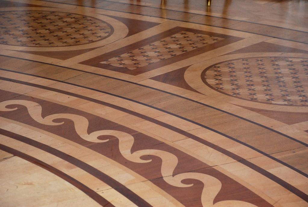 Intricate wood floor ball chamber floor jab onna palace for Hardwood flooring 78666
