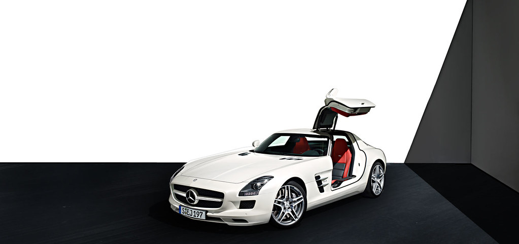 the mercedes benz sls amg white one door open the. Black Bedroom Furniture Sets. Home Design Ideas
