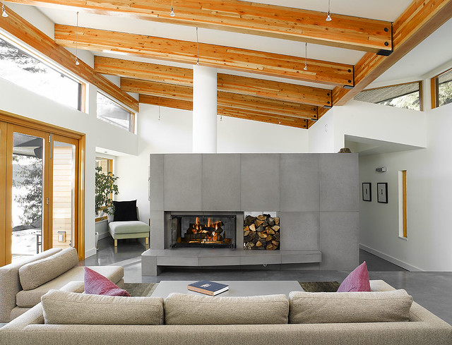Solus concrete wall tiles used for a double sided fireplac for How to build a double sided fireplace