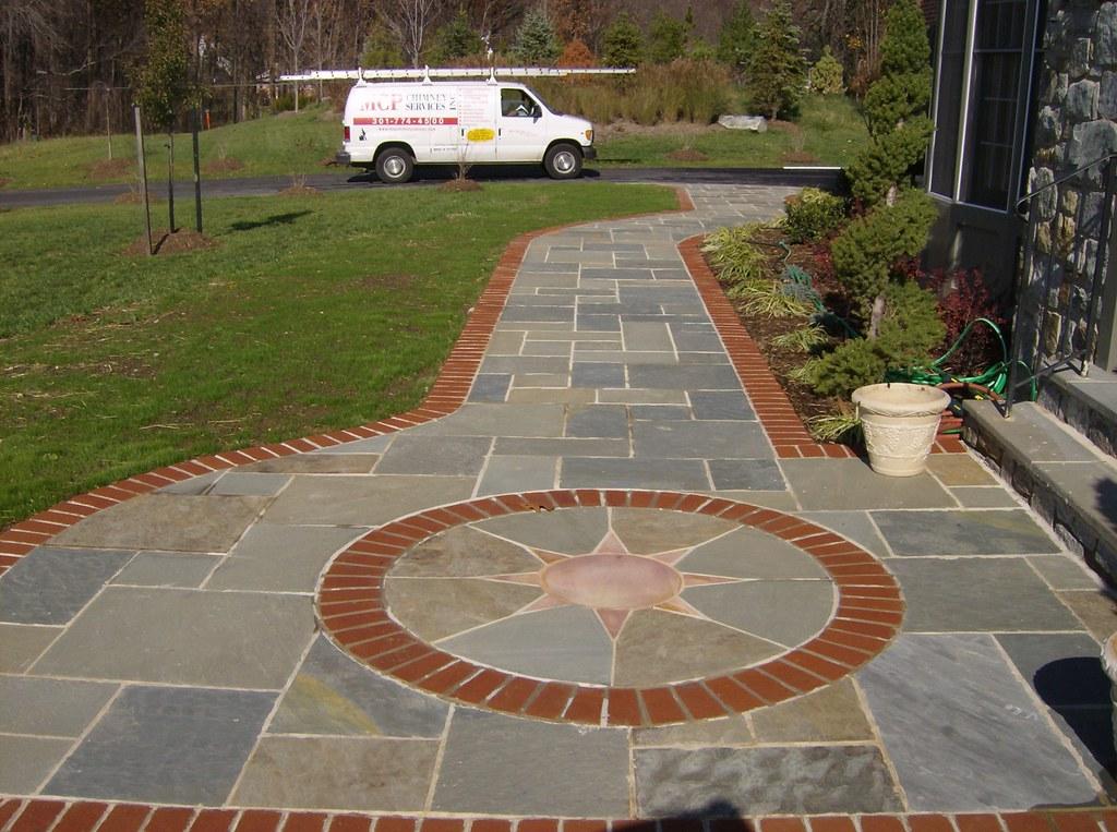 Random Pattern Flagstone Walkway with Brick Border & Sunbu ...