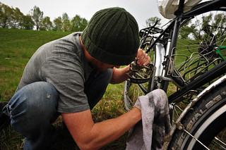 Tyler Cleaning our Bikes | by goingslowly