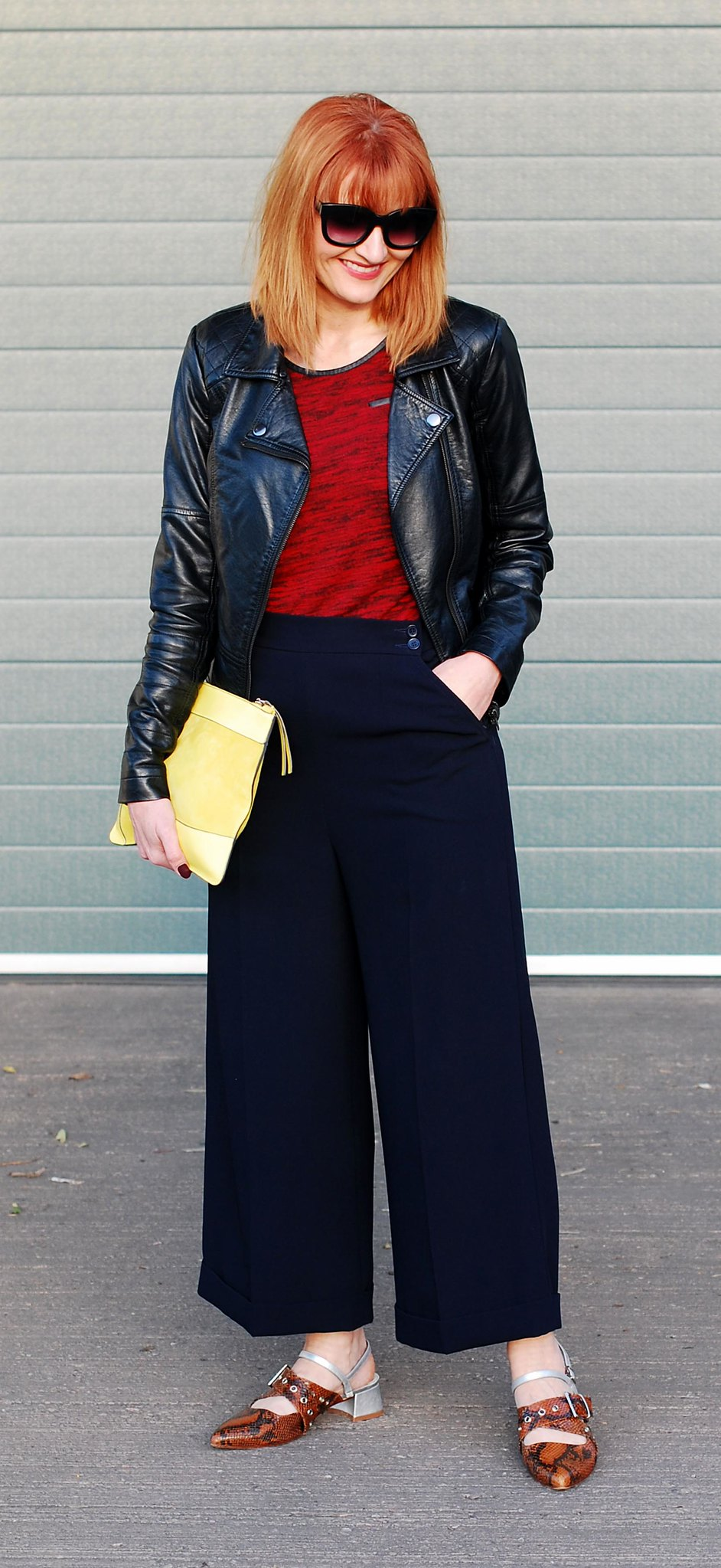 Corporate rock chic look: Black biker jacket  red textured t-shirt  navy culottes  Finery pointed strappy snakeskin buckle shoes  neon yellow suede clucth | Not Dressed As Lamb, over 40 style