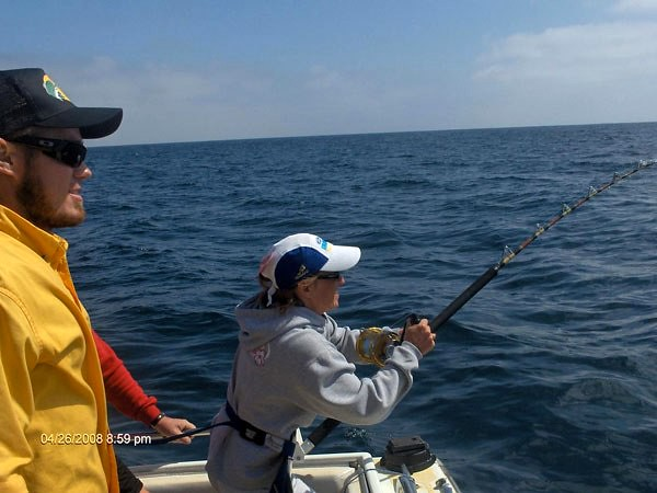 San diego fishing charter fish taxi reeling in a fish on for San diego fishing charter