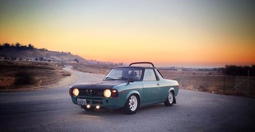 1979 Subaru Brat Turd Sitting In Front Of The Sunset