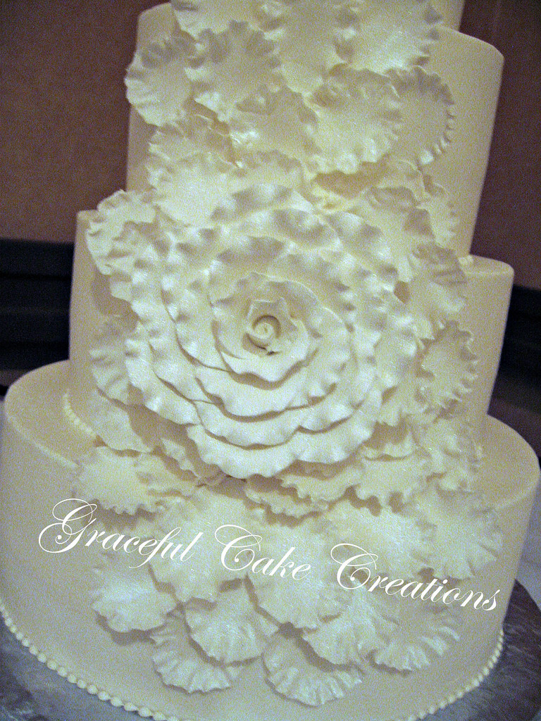 wedding cake with rose petals white wedding cake with a petal cascade flickr 26958