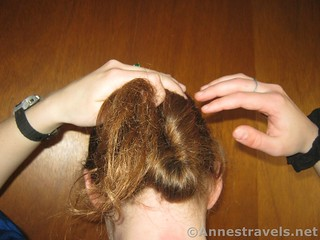 Switch which hand is holding the top of the oval while making a Hair Elastic Twist Up - 12 Hiking Hairstyles that are Pretty & Practical