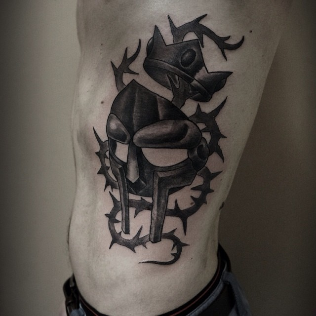 Mf doom mfdoom mask rep tattoo blackwork black in for Mf doom tattoo