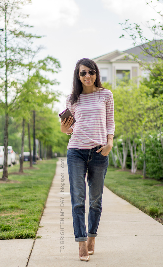 pink striped top, girlfriend jeans, taupe clutch, nude pumps, rose gold cuff