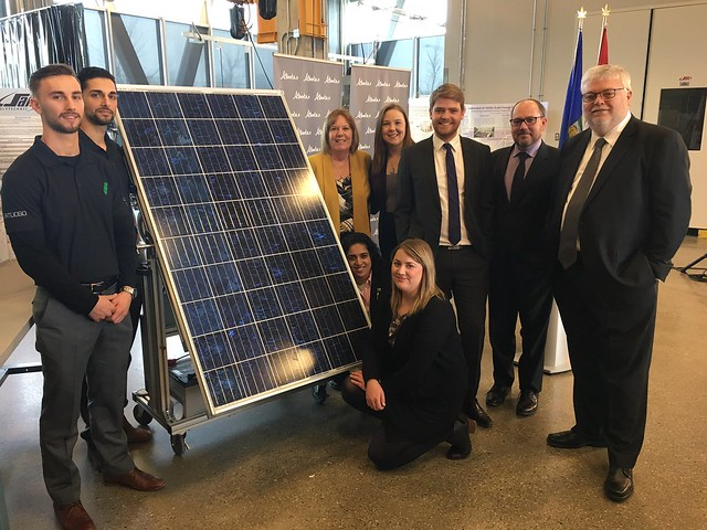 Energy Minister with Calgary MLAs, SAIT officials and graduates