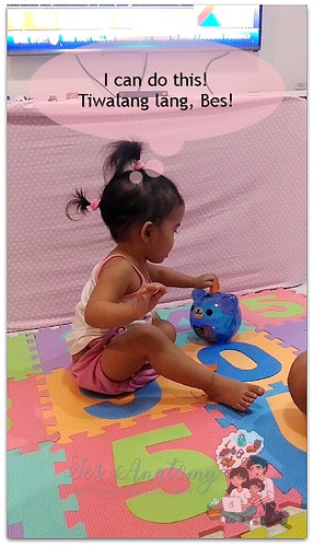 activities for toddlers playing with coin bank