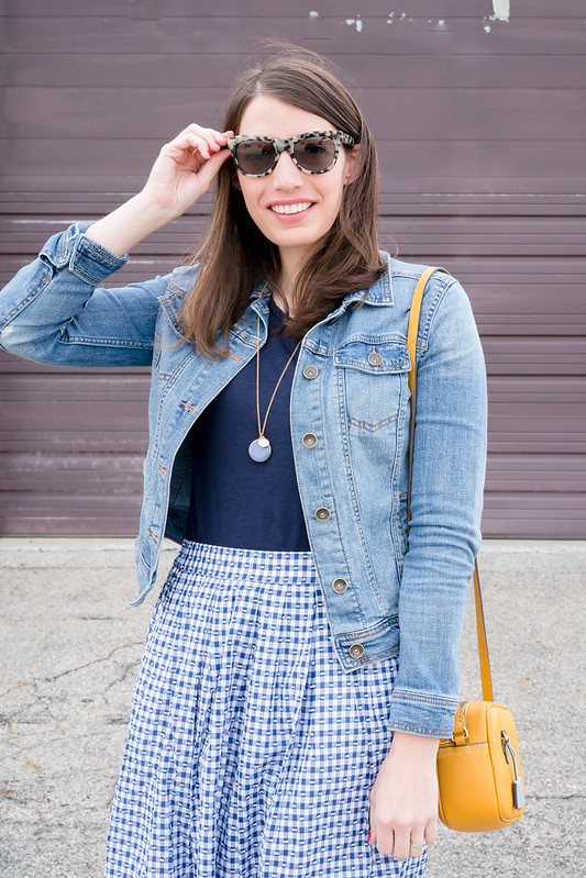 j.crew gingham skirt + navy tee + denim jacket + yellow crossbody purse + navy ballet flats + J.Crew tortoise sunglasses; spring casual outfit | Style On Target blog