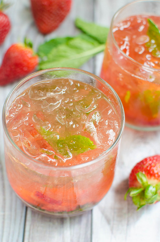 Strawberry Basil Bourbon Smash - juicy strawberries and fresh basil are the perfect pair in this bourbon cocktail recipe!