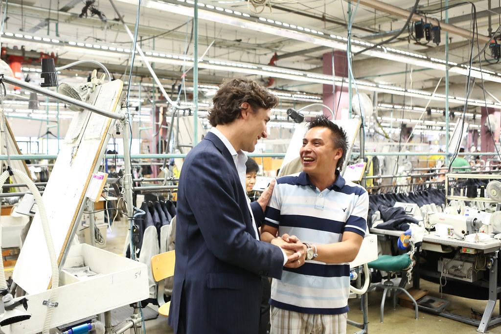 Justin tours the Vêtements Peerless Clothing Inc. plant i ...