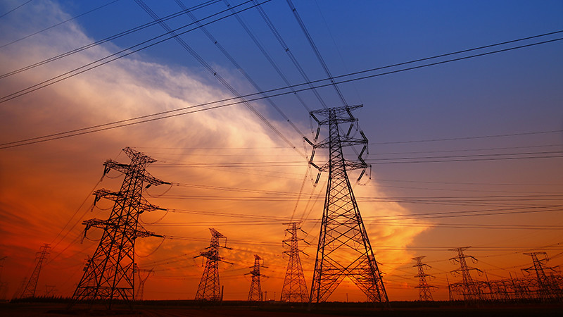 A picture of pylons set against a sunset sky
