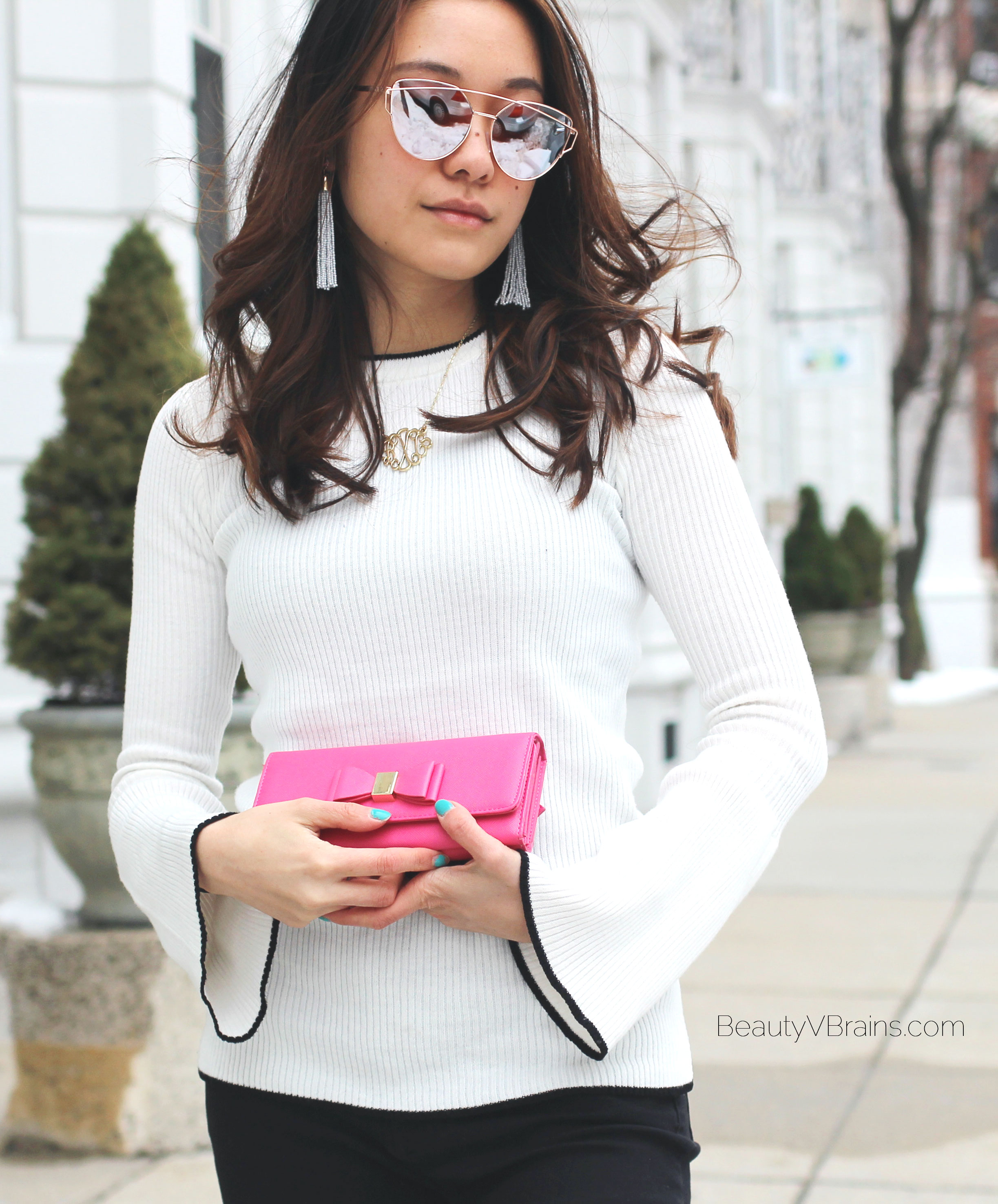 Bell sleeve sweater with black trim and pink bow wallet