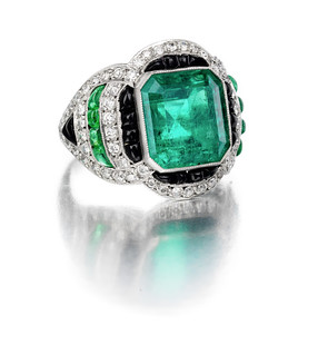 An emerald, diamond and onyx ring 20