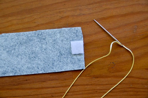 3. Push needle from back of Velcro square to front.