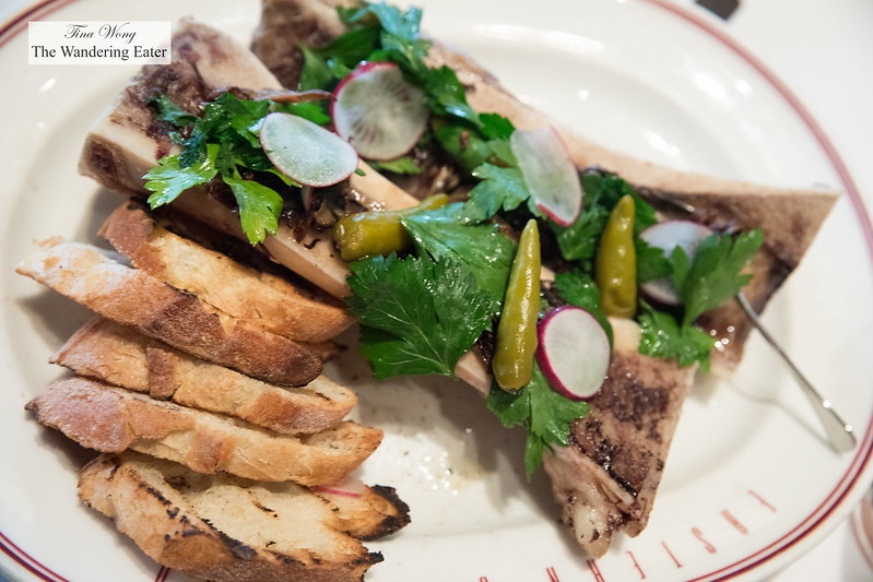 Roasted bone marrow with pickled peppers, parsley and radishes