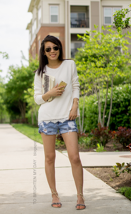 white sweater with lace hem, distressed shorts, wildflower cuff, lace printed clutch, suede sandals with jewels