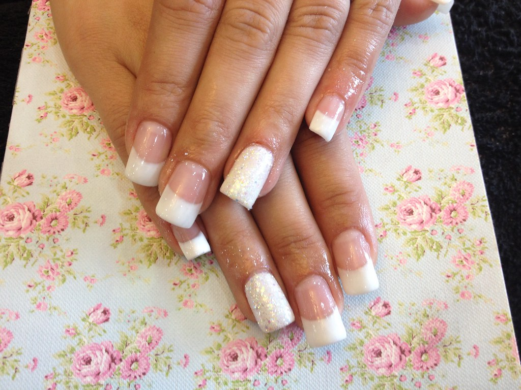 Full Set Of Acrylic Nails With White French And Glitter Ring Finger