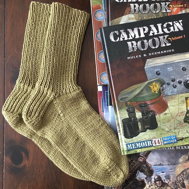 Socks done. Memoir '44 campaign books out. Ready to set up some tabletop battles. #knitting