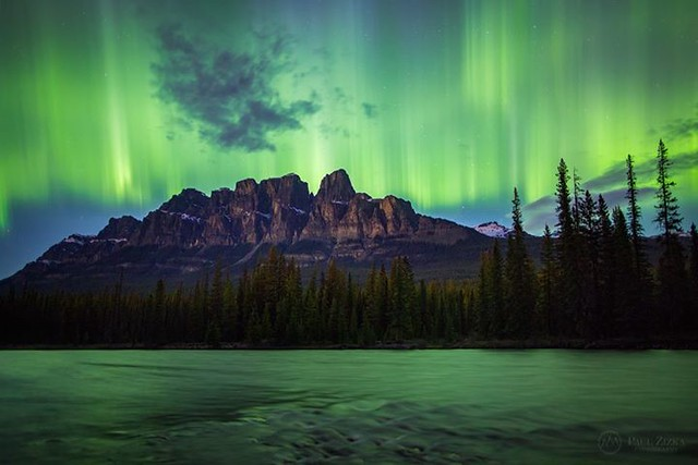 One of those rare nights when the aurora is rippling so fast across the sky it's hard to keep up. Everything starts glowing green around you. Shutter speeds of one second bring out the wonderful structure of the emerald curtains. A true gift. Unforgettabl