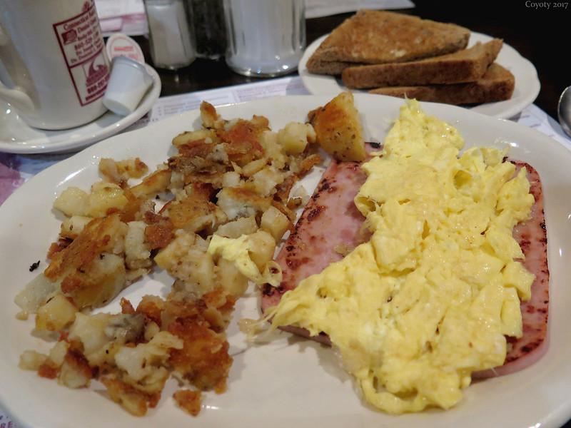 Scrambled eggs and ham steak
