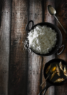 A small scoop of rice and couple of those tiny little fried fish (may be) ... that is what the poor peasants in Bangladesh live on. Everyday. | by Nusrat Suborna