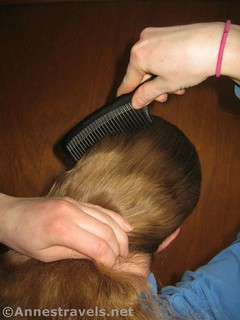 Comb back the hair to make a ponytail - 12 pretty & practical hiking hairstyles