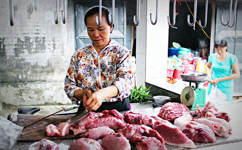 Selling pork in a traditonal Vietnamese market