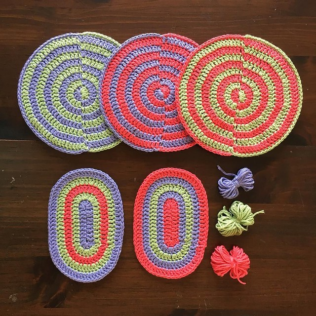 Three new double-thick hot pads and two little oval rugs. #crochet