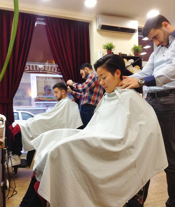 Freaking out the Romanian men by getting a cut at the men's barber