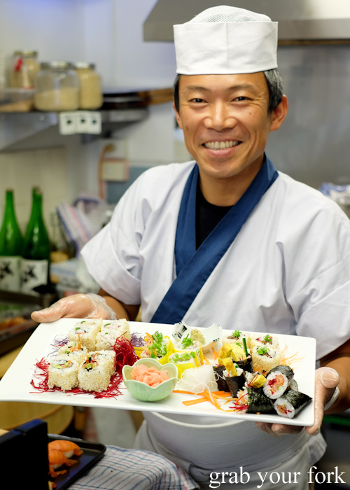Sushi chef Masaaki Koyama with a platter of sushi at Masaaki's Sushi in Geeveston, Tasmania