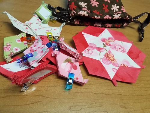 Starting a new project this week. It's called 7 sisters and is all diamonds. Inspired by Bonnie Hunter and using my Sakura charm pack. The bag @cre8tivequilter made me when I first started English Paper Piecing in 2010 is still my go to EPP travel bag.