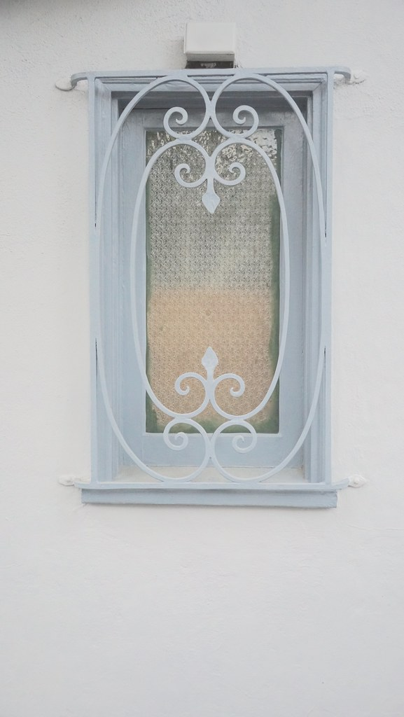 blue window frame matching decorative security bars DSC015… | Flickr