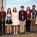 From left: Kathy Keith, director of Los Alamos National Laboratory's Community Partnerships Office and Supercomputing Challenge winners Theo Goujon, Lisel Faust, Ramona Park, Rowan Cahill, and their teachers Hope Cahill and Brian Smith, and Shaun Cooper, the awards ceremony MC.