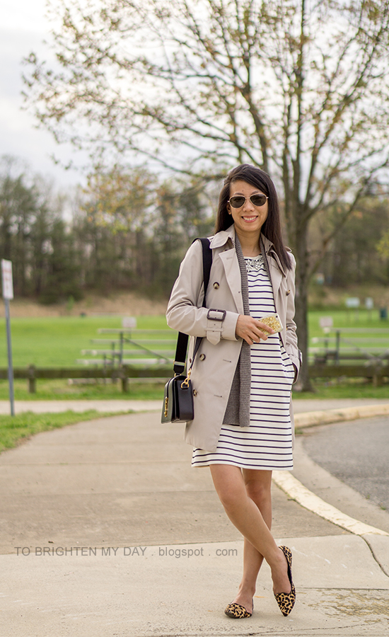 trench coat, taupe open cardigan sweater, striped dress with jeweled neckline, black shoulder bag, leopard flats