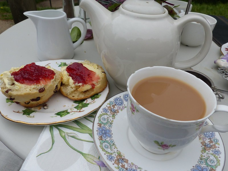 this is a picture of a scone and a cup of tea