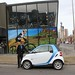 #8 Best of 2013: Car Sharing – John Wycoco Location Manager of Car2Go in Calgary, Alberta demonstrates how easy it is to find a car, swipe his member card to start a car rental. Carsharing appears to be catching on in several Canadian cities.