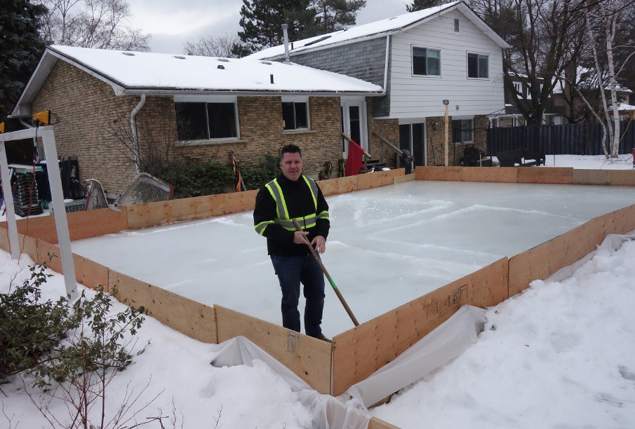 Keith Travers stands at the back corner of his backyard ice skating rink - DIY Backyard Ice Rink Hockey Dad, Keith Travers |