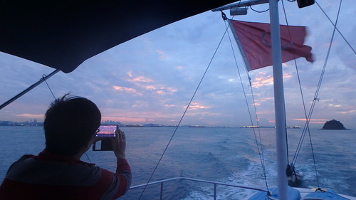 Sunrise over Pulau Jong on the way to survey
