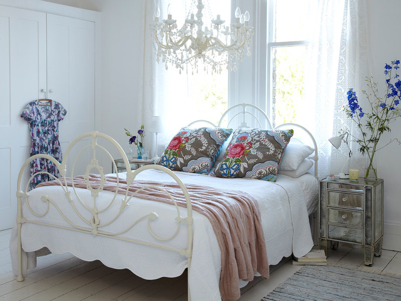Spring Bedding | White Iron Bed Frame and Floral Pillows
