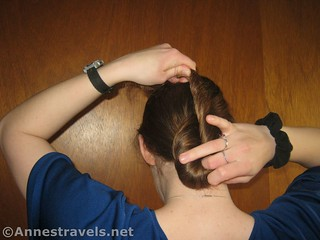 Twist the hair into a vertical oval when making a Hair Elastic Twist Up - 12 Hiking Hairstyles that are Pretty & Practical